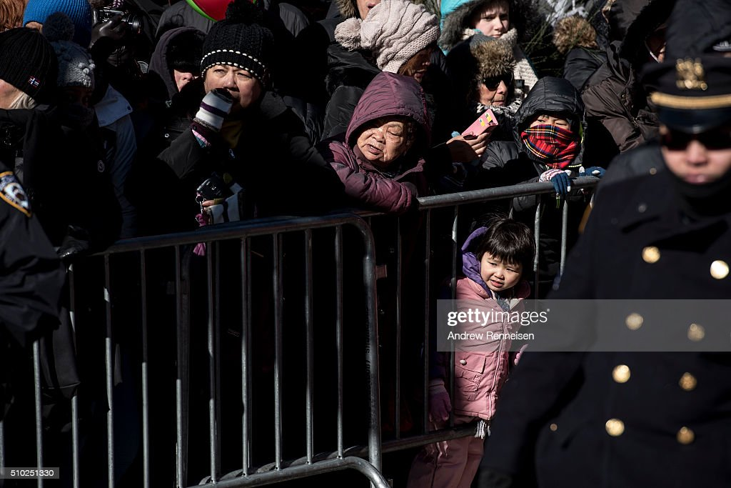 People gather for a Lunar New Year's parade in Chinatown in New York City on February 14, 2016. The new year starts the year of the monkey.