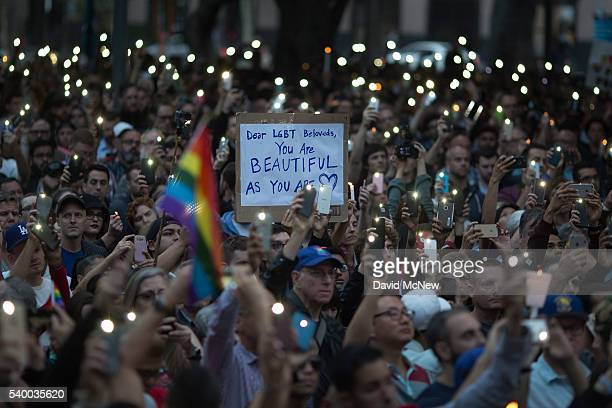 People gather for a vigil for the worst mass shooing in United States history on June 13 2016 in Los Angeles United States A gunman killed 49 people...