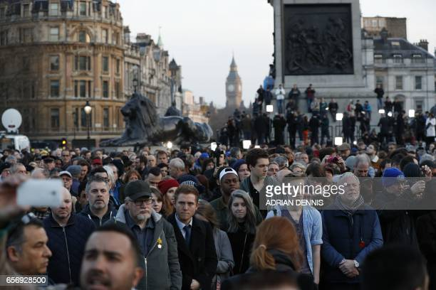People gather for a vigil in Trafalgar Square in central London on March 23 2017 in solidarity with the victims of the March 22 terror attack at the...