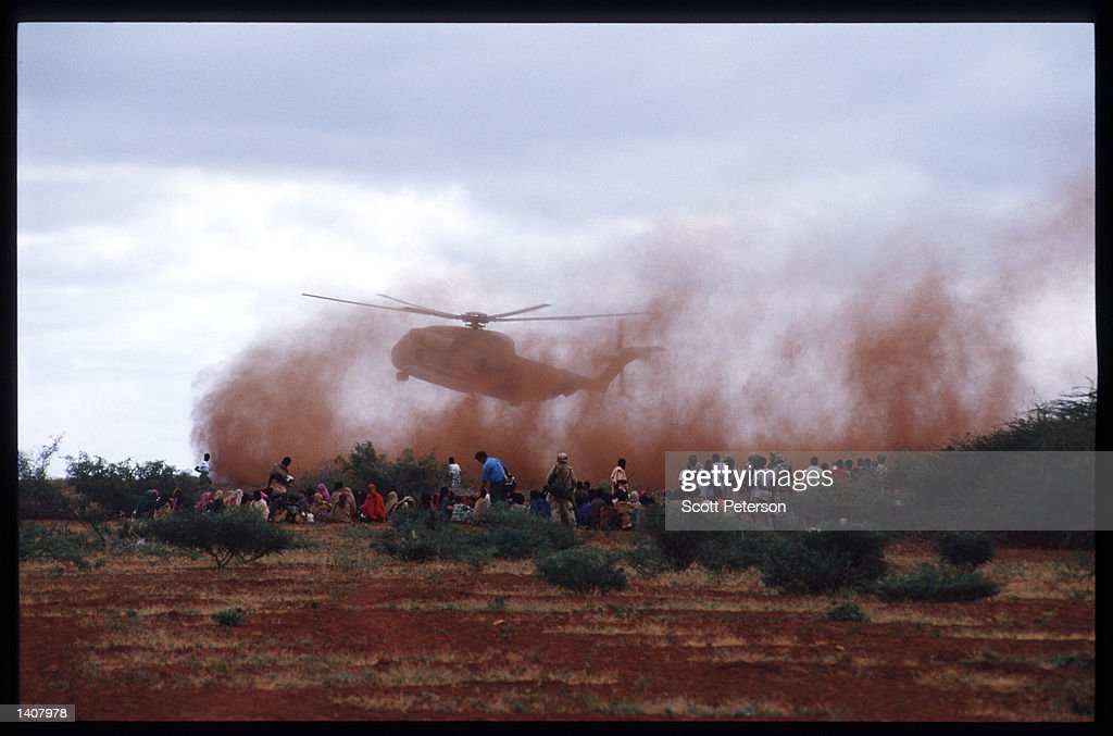 People gather for food distribution January 15 1993 in Labatan Jirow Somalia US troops arrived in 1992 marking the beginning of a UN peacekeeping...