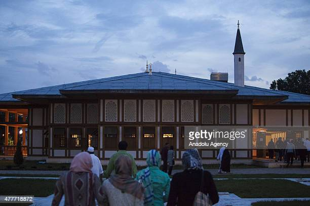 People gather for Iftar at the Turkish American Community Center in Lanham Maryland on the first day of Islam's holy fasting month of Ramadan on June...