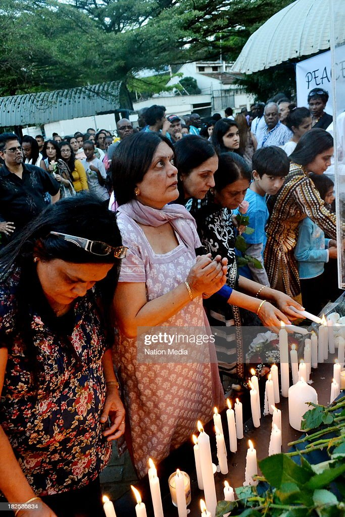 People gather for prayers and tributes for the Westgate Terror attack victims on September 27 2013 outside Westgate Maill in Nairobi Kenya The event...