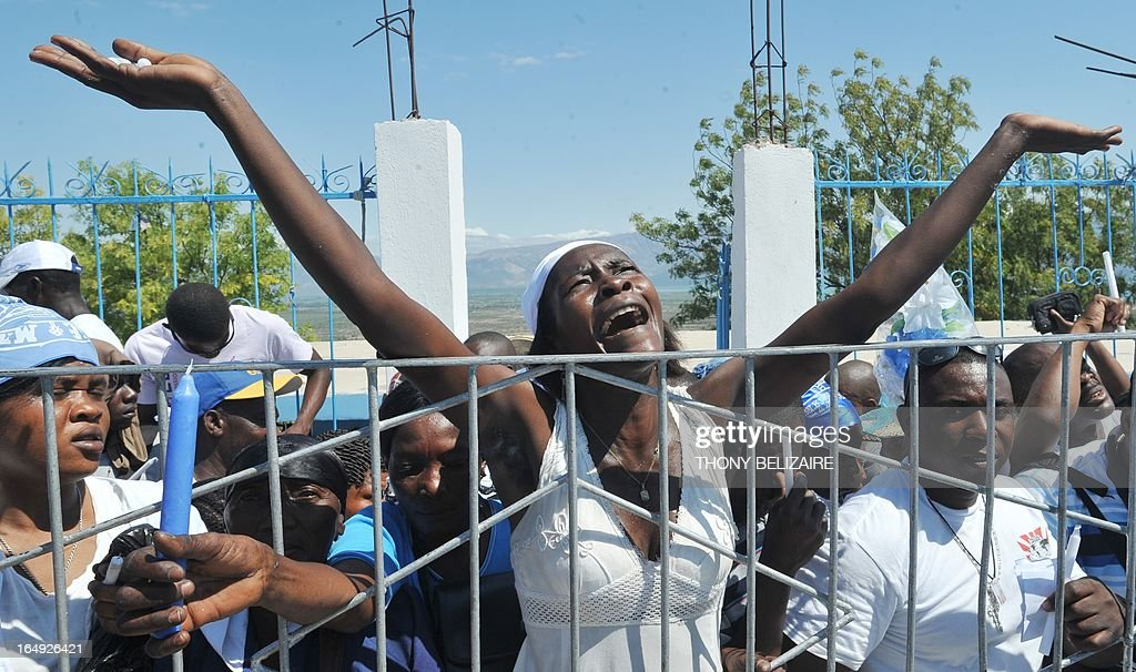 People gather for the annual Good Friday pilgrimage before Easter on March 29, 2013 at Morne Calvaire, near Port-au-Prince. AFP PHOTO Thony BELIZAIRE