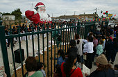 People gather for the ceremony marking the completion of the Santa Statue restoration in Oxnard Mike Barber spearheaded the effort to save the...