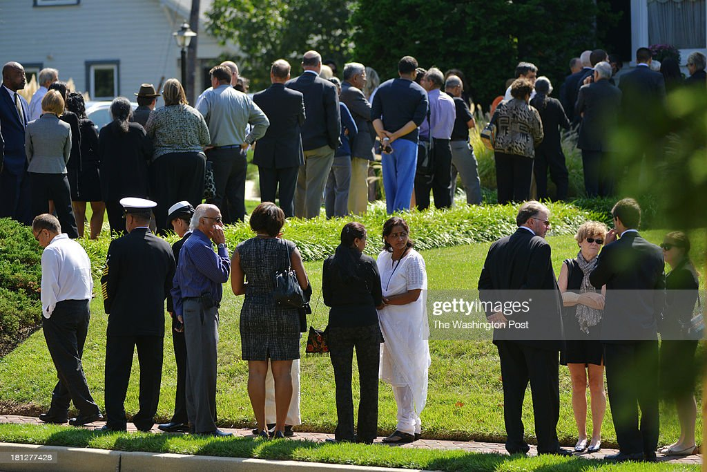 People gather for the memorial service of Vishnu B. Pandit, 61, at the Robert A. Pumphrey Funeral Home on Thursday, September 19, 2013, in Rockville, MD. The memorial service is the first for the victims of Monday's mass shooting at the Washington Navy Yard. Pandit, who lived in North Potomac, MD, grew up in India and moved with his family to the United States in 1974. Pandit worked as a civilian for the Navy for more than 25 years.