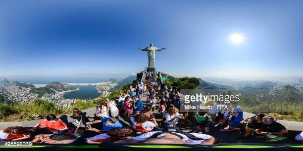 People gather for the view near the Christ the Redeemer statue ahead of the 2014 FIFA World Cup on June 4 2014 in Rio de Janeiro Brazil