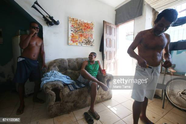 People gather in a home in the Gamboa de Baixo community on April 19 2015 in Salvador Brazil