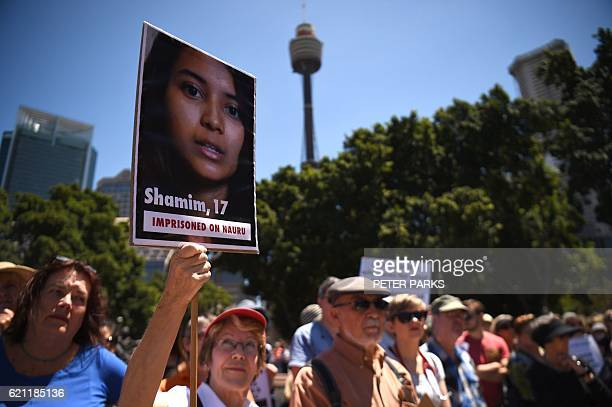 People gather in a park before marching in an event organised by Doctors for Refugees to demand humane treatment of asylum seekers and refugees in...