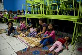 People gather in a shelter in Cabo San Lucas Baja California State Mexico on September 14 2014 Hurricane Odile swirled menacingly toward Mexico's Los...
