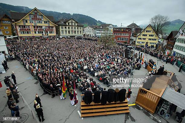 People gather in a square in the town of Appenzell eastern Switzerland to vote during the annual Landsgemeinde meeting on April 28 2013 Appenzell is...