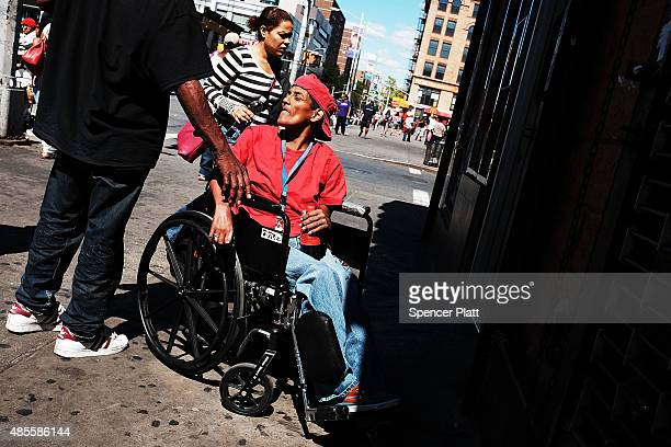 People gather in an area of East Harlem where K2 or 'Spice' a synthetic marijuana drug is often consumed on August 28 2015 in New York City New York...