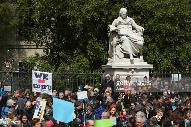 People gather in front of Humboldt University in support of scientific research during the 'March for Science' demonstration on April 22 2017 in...