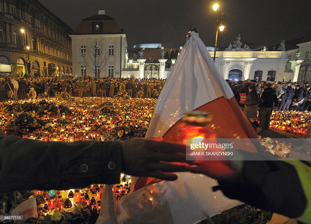 People gather in front of presidential palace on April 10 2010 in Warsaw following the Polish government Tupolev Tu154 aircraft crash near Smolensk...