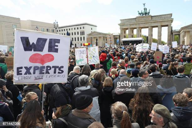People gather in front of the Brandenburg Gate in support of scientific research during the 'March for Science' demonstration on April 22 2017 in...