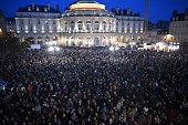 People gather in front of the city hall of Rennes western France on January 7 following an attack by unknown gunmen on the offices of the satirical...