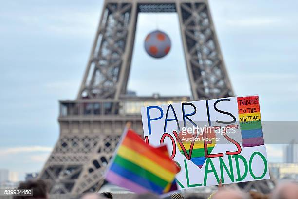 People gather in front of the Eiffel Tower on Place du Trocadero during the vigil for victims of the Orlando Florida nightclub shooting on June 13...