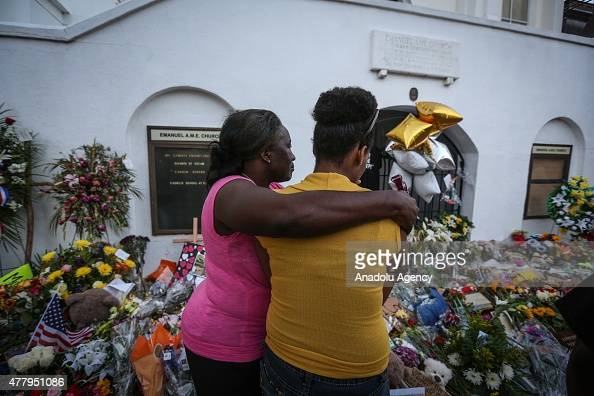 People gather in front of the Emanuel AME Church to pay respect to the nine shooting victims on June 20 in Charleston South Carolina USA