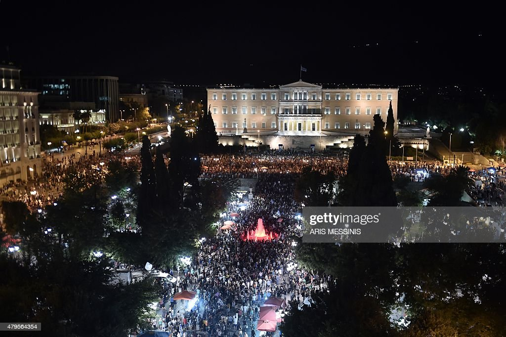 People gather in front of the Greek Parliament in Athens on July 5 after early results showed those who rejected further austerity measures in a...