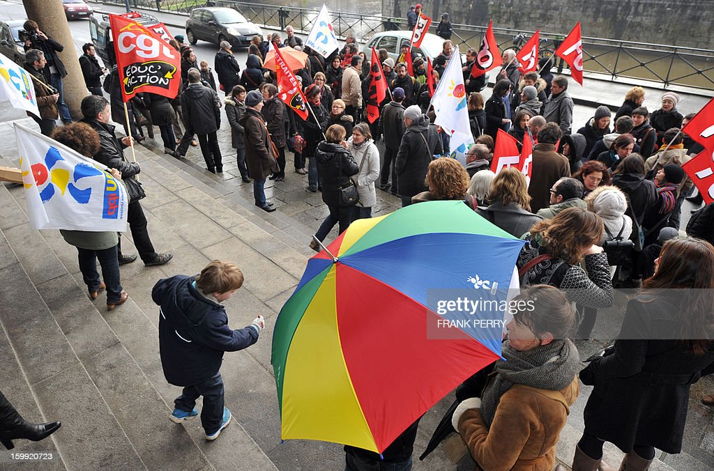 People gather in front of the headquarters of the local office of the Education department, on January 23, 2013, in Rennes, as they take part in a nationwide strike and protest action against a proposed reform to increase the class time of primary school students. Around 80 people gathered in Rennes as several hundred other teachers gathered at protest rallies in various cities across the country.