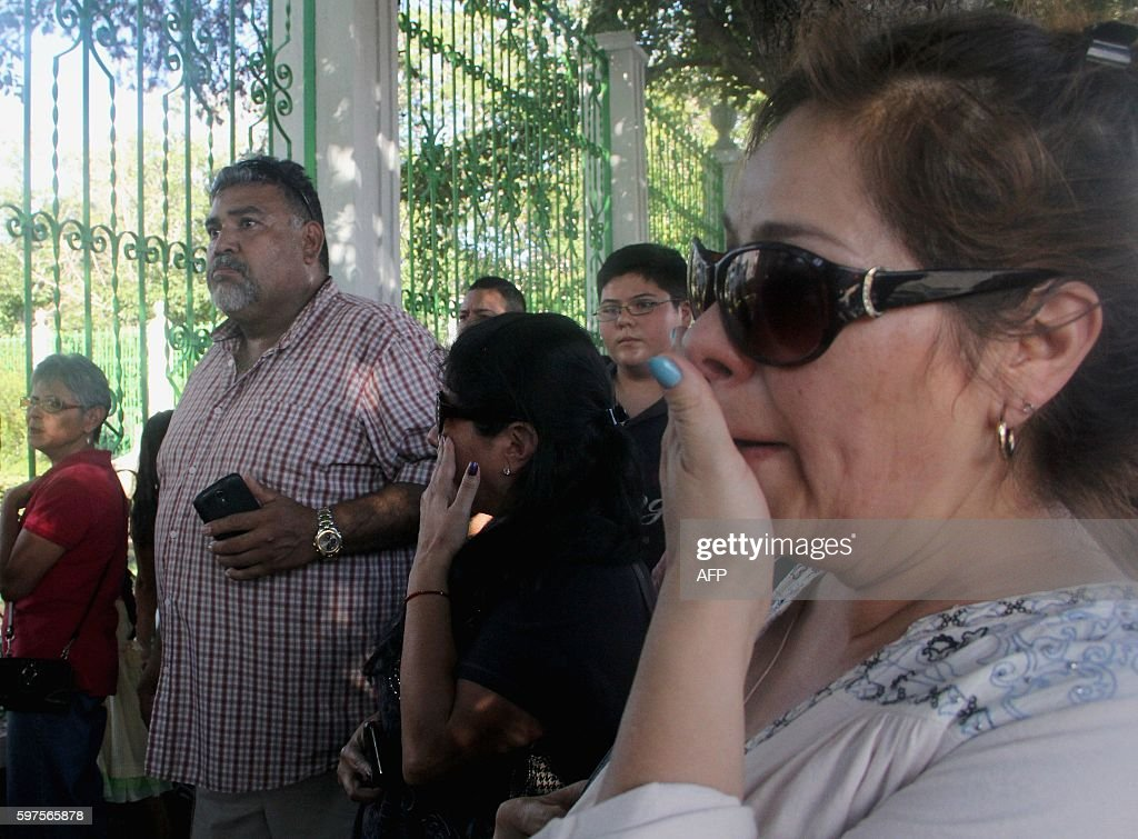 People gather in front of the house of Mexican singer Juan Gabriel in Ciudad Juarez Mexico on August 28 2016 Mexican singer composer and producer...