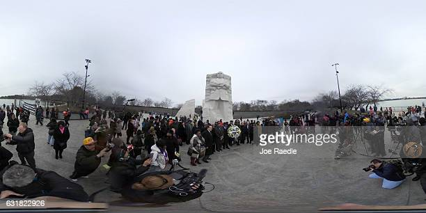 People gather in front of the Martin Luther King Jr memorial to honor him on Martin Luther King day on January 16 2017 in Washington DC Martin Luther...
