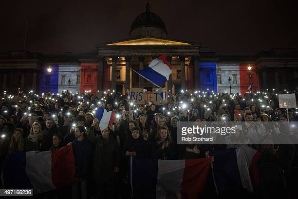 People gather in front of the National Gallery during a vigil for victims of the Paris terrorist attacks in Trafalgar Square on November 14 2015 in...