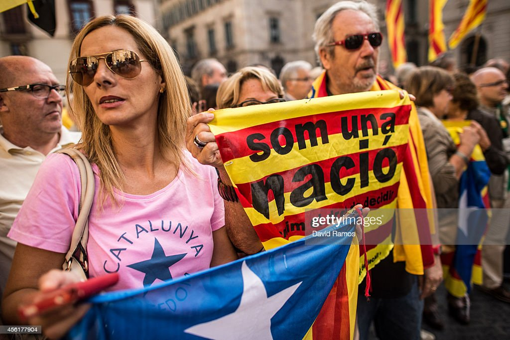 People gather in front of the Palau de la Generalitat the Catalan government building during a proindependence demonstration on September 27 2014 in...