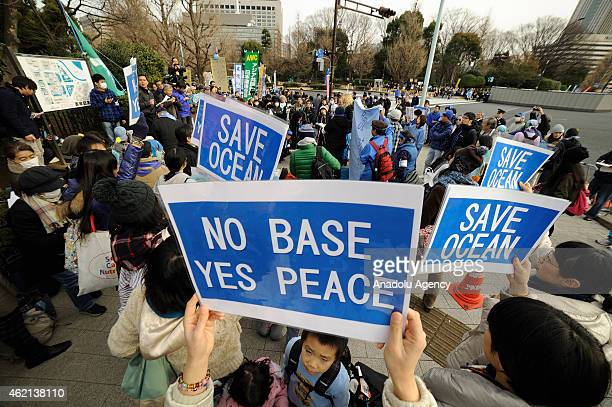 People gather in front of the parliament building in Tokyo Japan on January 25 to protest against the presence of US military bases in Okinawa land...