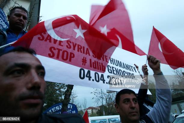 People gather in front of the Russian Embassy of Ankara to condemn Assad regime forces' suspected chemical gas attack in the oppositionheld Syrian...