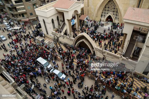 People gather in front of the Saint George church after a bombing struck inside the church in the Nile Delta city of Tanta Egypt on April 9 2017 At...