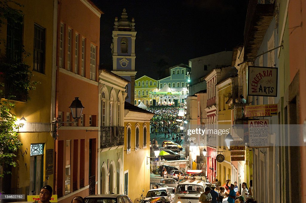 People gather in front of the stage at Larga do Pelourinho in Salvador northeastern Brazil during Dia do Samba on December 2 2011 The date...