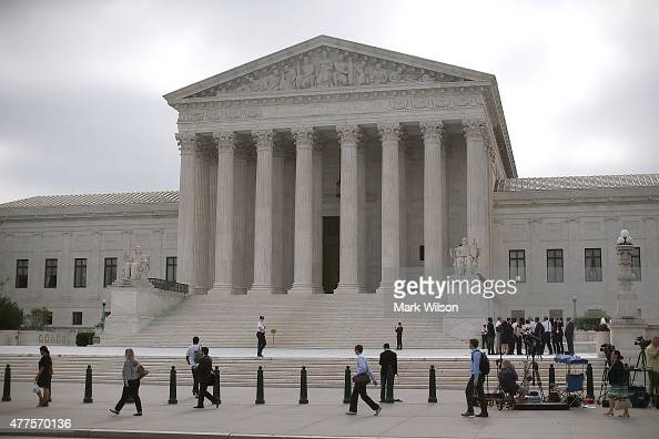 People gather in front of the Supreme Court Building June 18 2015 in Washington DC This month the high court is expected to hand down its ruling on...