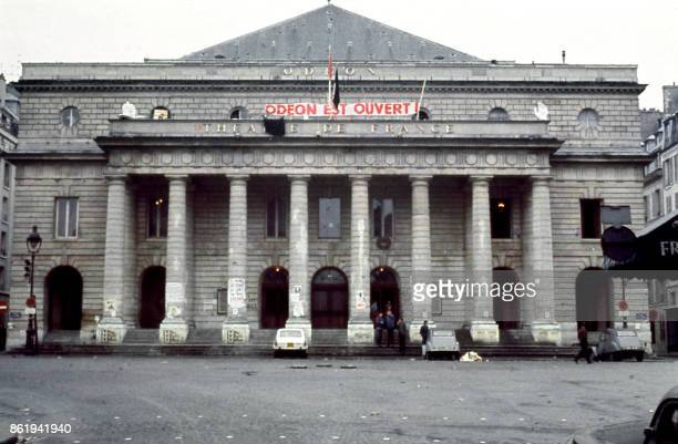 People gather in front of the 'Theatre de l'Odeon' occupied by strikers in Paris 17 May 1968 during the MayJune 1968 events in France Starting as a...