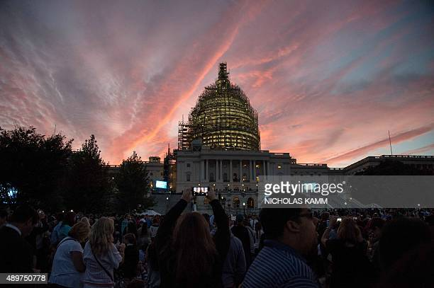 People gather in front of the US Capitol in Washington DC on September 24 2015 before Pope Francis addresses a Joint Session of Congress on the third...