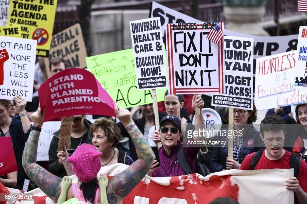 People gather in front of Trump Tower to celebrate defeat of US President Donald Trump's revision of the Affordable Care Act in Chicago United States...