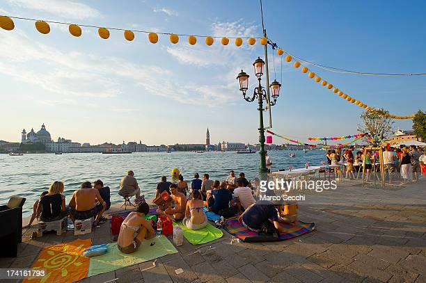 People gather in Giudecca for the Redentore Celebrations on July 20 2013 in Venice Italy Redentore which is in remembrance of the end of the 1577...