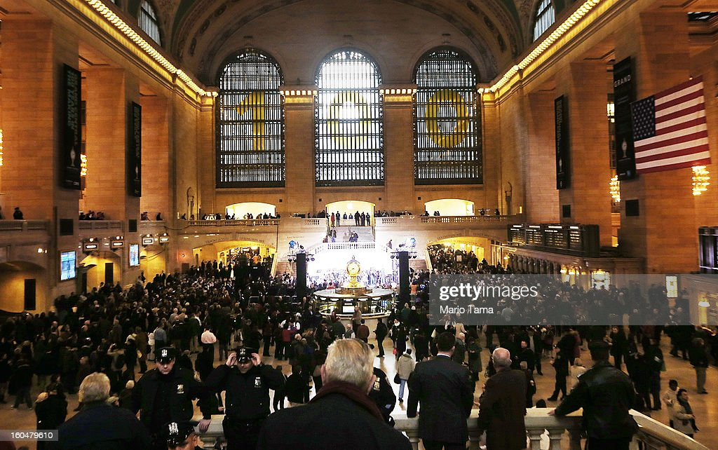 People gather in Grand Central Terminal beneath a '100' sign during centennial celebrations on the day the famed Manhattan transit hub turns 100 years old on February 1, 2013 in New York City. The terminal opened in 1913 and is the world's largest terminal covering 49 acres with 33 miles of track. Each day 700,000 people pass through the terminal where Metro-Noth Railroad operates 700 trains per day.