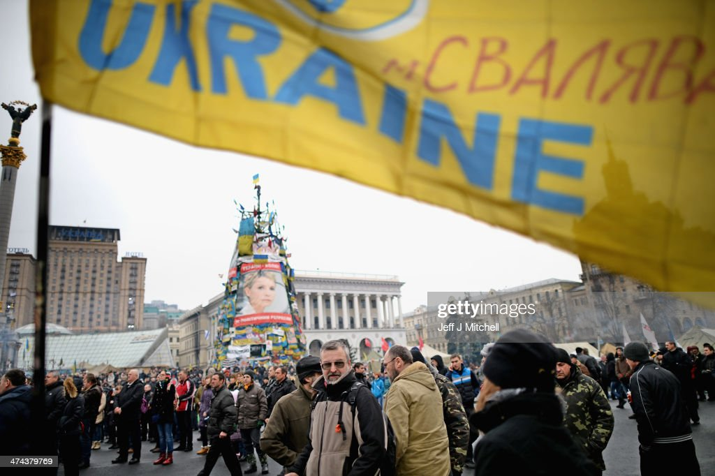 People gather in independence square on February 23, 2014 in Kiev, Ukraine. Prime Minister Yanukovych is said to have left Kiev for a eastern stronghold as the country's parliament voted to remove Yanukovych from office and call for new elections.