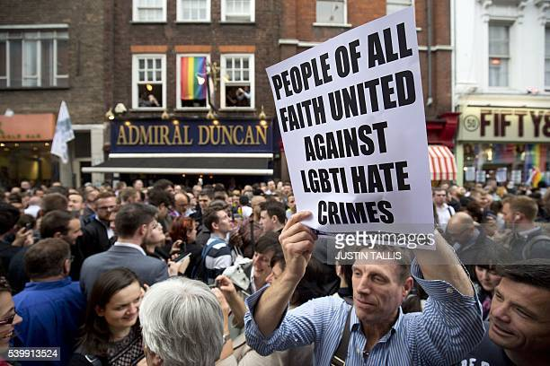 People gather in Old Compton Street in the Soho district of London for a vigil in commemoration and solidarity with the victims of the Orlando...