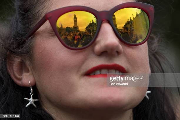 People gather in Parliament Square to listen to the final chimes of Big Ben ahead of a fouryear renovation plan on August 21 2017 in London England...