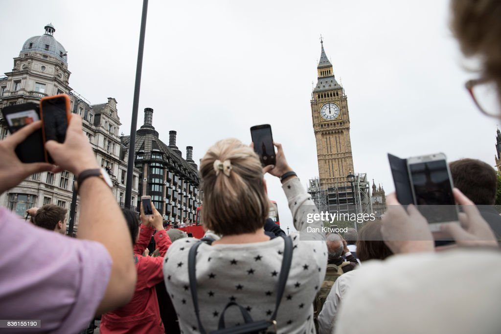 People gather in Parliament Square to listen to the final chimes of Big Ben ahead of a four-year renovation plan, on August 21, 2017 in London, England. The bell will still be used for special occasions such as marking New Year, but will remain silent on a daily basis, to allow the work teams to carry out structural repairs.