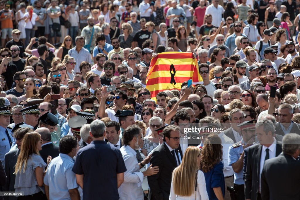 People gather in Placa de Catalunya to observe a one minute's silence for the victims of yesterday's terrorist attack, on August 18, 2017 in Barcelona, Spain. Fourteen people were killed and dozens injured when a van hit crowds in the Las Ramblas area of Barcelona on Thursday. Spanish police have also killed five suspected terrorists in the town of Cambrils to stop a second terrorist attack.