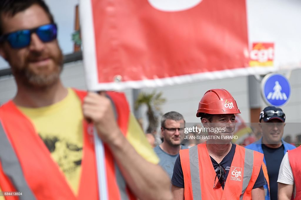 People gather in Saint-Nazaire, western France, to protest against the government's planned labour law reforms on May 26, 2016. France's Socialist government has bypassed parliament and rammed through a labour reform bill that has sparked two months of massive street protests. EVRARD