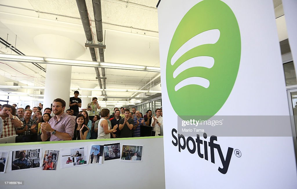 People gather in Spotify offices following a press conference on June 27, 2013 in New York City. Spotify will add 130 tech and engineering jobs in New York and expand to a new office in the Chelsea neighborhood of Manhattan.