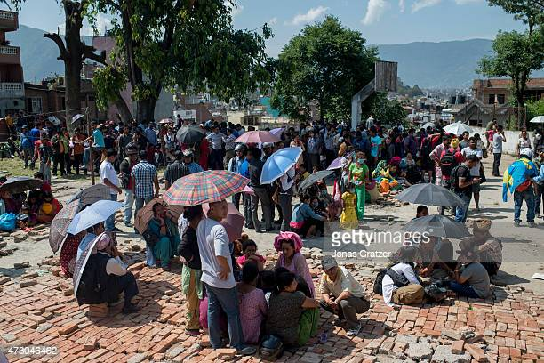 People gather in the safety of open space following a further major earthquake on May 12 2015 in Kathmandu Nepal A 73 magnitude earthquake has struck...