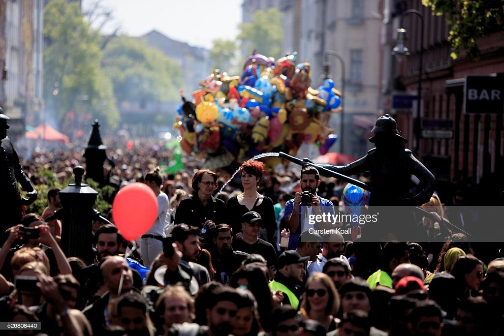 People gather in the street at th annual Myfest in District Kreuzberg afternoon before several demonstrations on May, 2016 in Berlin, Germany. Tens of thousands of people across Germany participated in marches and gatherings by labor unions and in some cities left-wing and anarchist activists took to the streets under heavy oversight by police. In Berlin far-right protesters also attempted to hold rallies during the day.