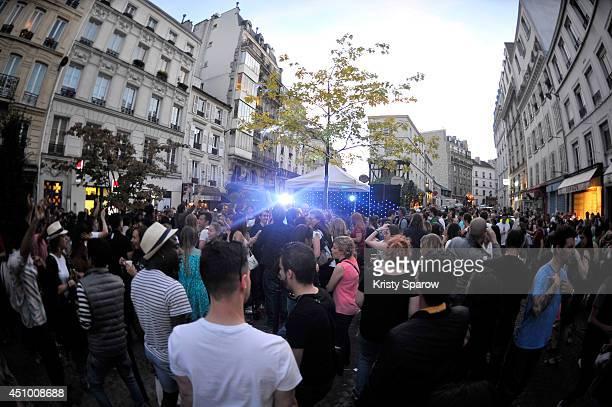 People gather in the streets of Paris to celebrate the summer solstice during Fete De La Musique 2014 on June 21 2014 in Paris France Fete De La...