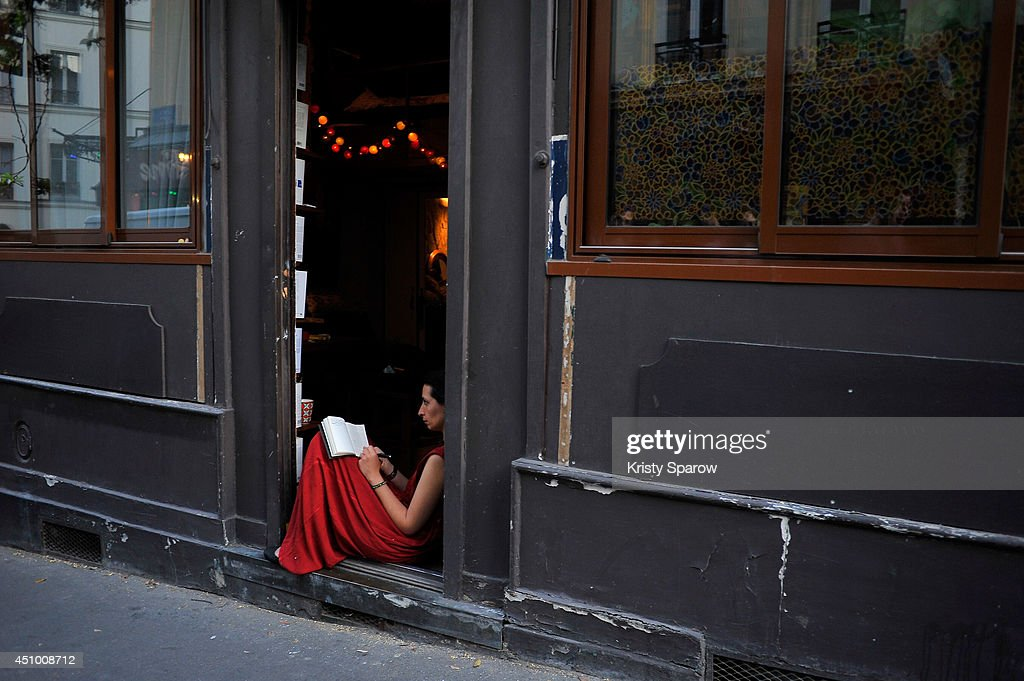 People gather in the streets of Paris to celebrate the summer solstice during Fete De La Musique 2014 on June 21, 2014 in Paris, France. Fete De La Musique is an annual event held throughout France where musicians perform in the streets.