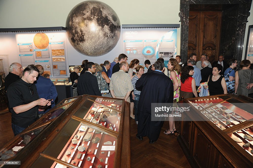 People gather in the the new meteorite hall during the handover of moon rocks from NASA Apollo Missons 15 and 17 at the Natural History Museum on June 18, 2013 in Vienna, Austria. The National Aeronautics and Space Administration (NASA) is loaning three samples of moon rocks long term to the Naturhistorisches Museum.