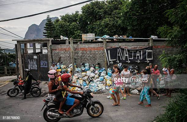 People gather in the Vidigal 'favela' or community on March 3 2016 in Rio de Janeiro Brazil The government announced that Brazil's economy shrank 38...